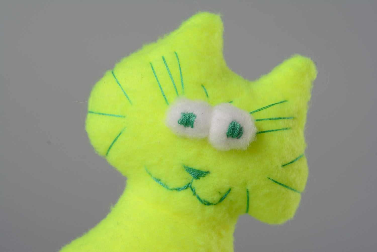 Soft toy in the shape of a yellow and green cat photo 2