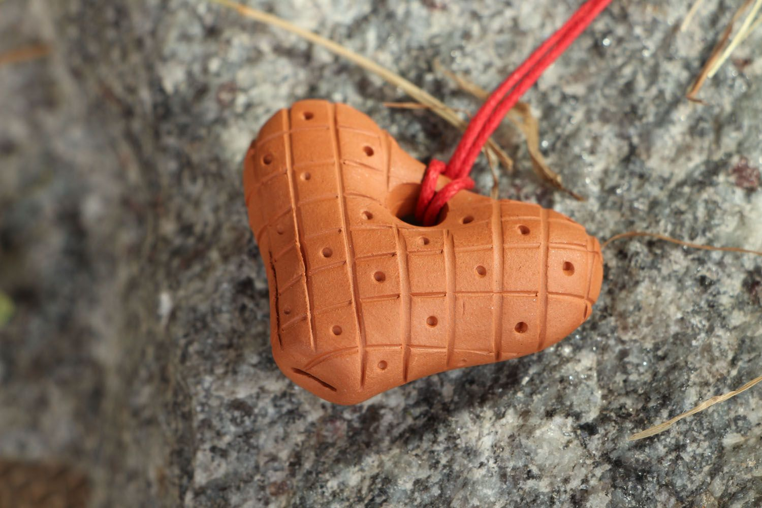 Clay penny whistle with a red cord photo 5