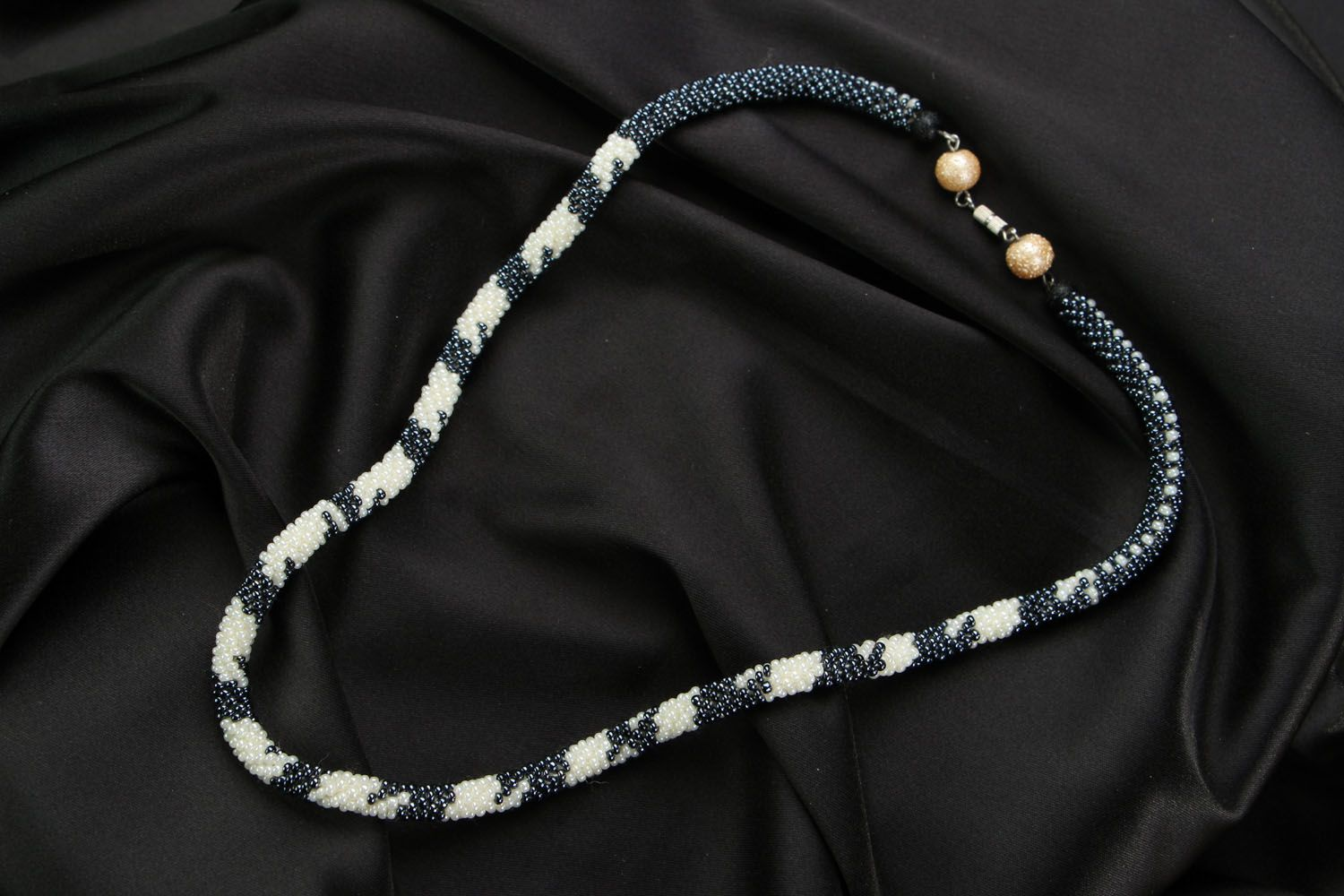 Beaded cord necklace Black-and-White photo 1