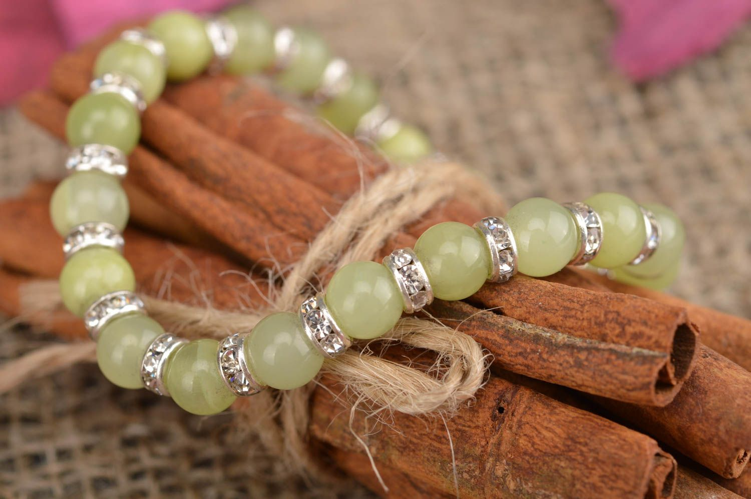 Handmade thin stylish bracelet made of beads of nephritic color for women photo 1