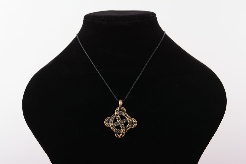 Bronze pendant with solar symbol photo 5
