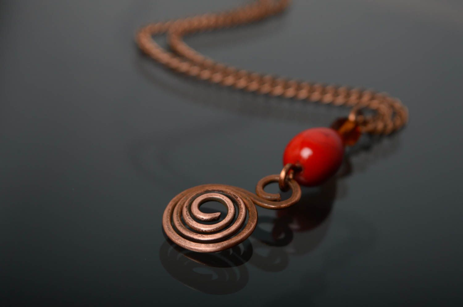 Copper pendant with natural coral photo 1