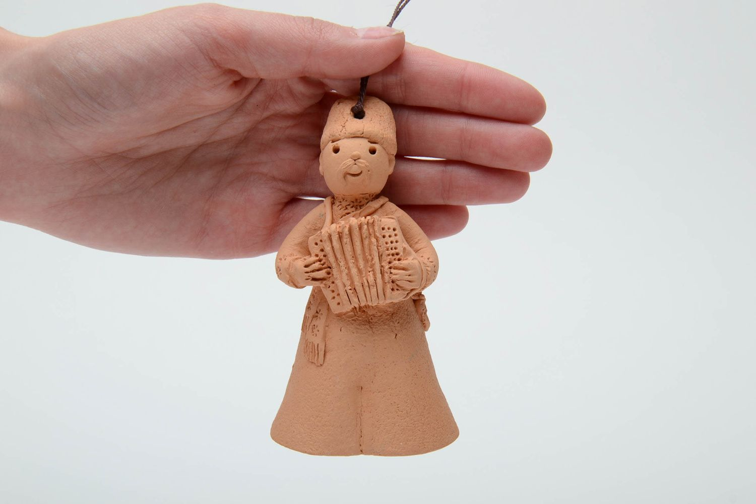Handmade clay bell in the shape of accordion player photo 5