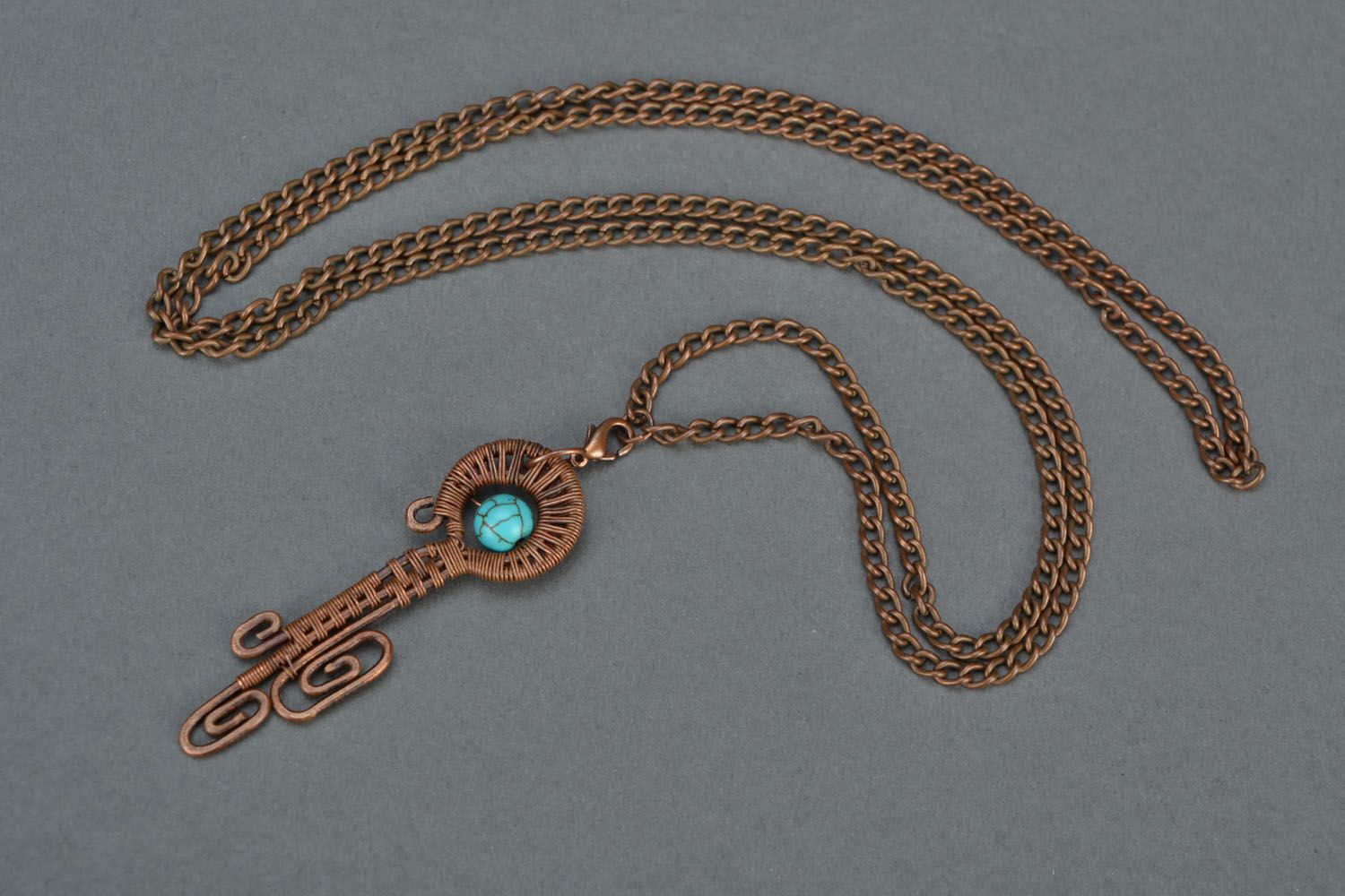 Copper wire pendant with turquoise photo 3