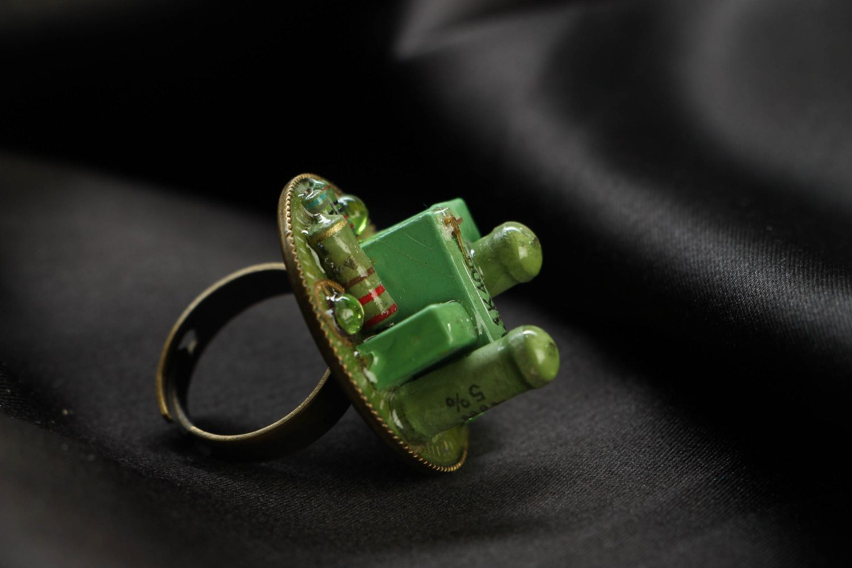 Green metal ring in cyberpunk style photo 1