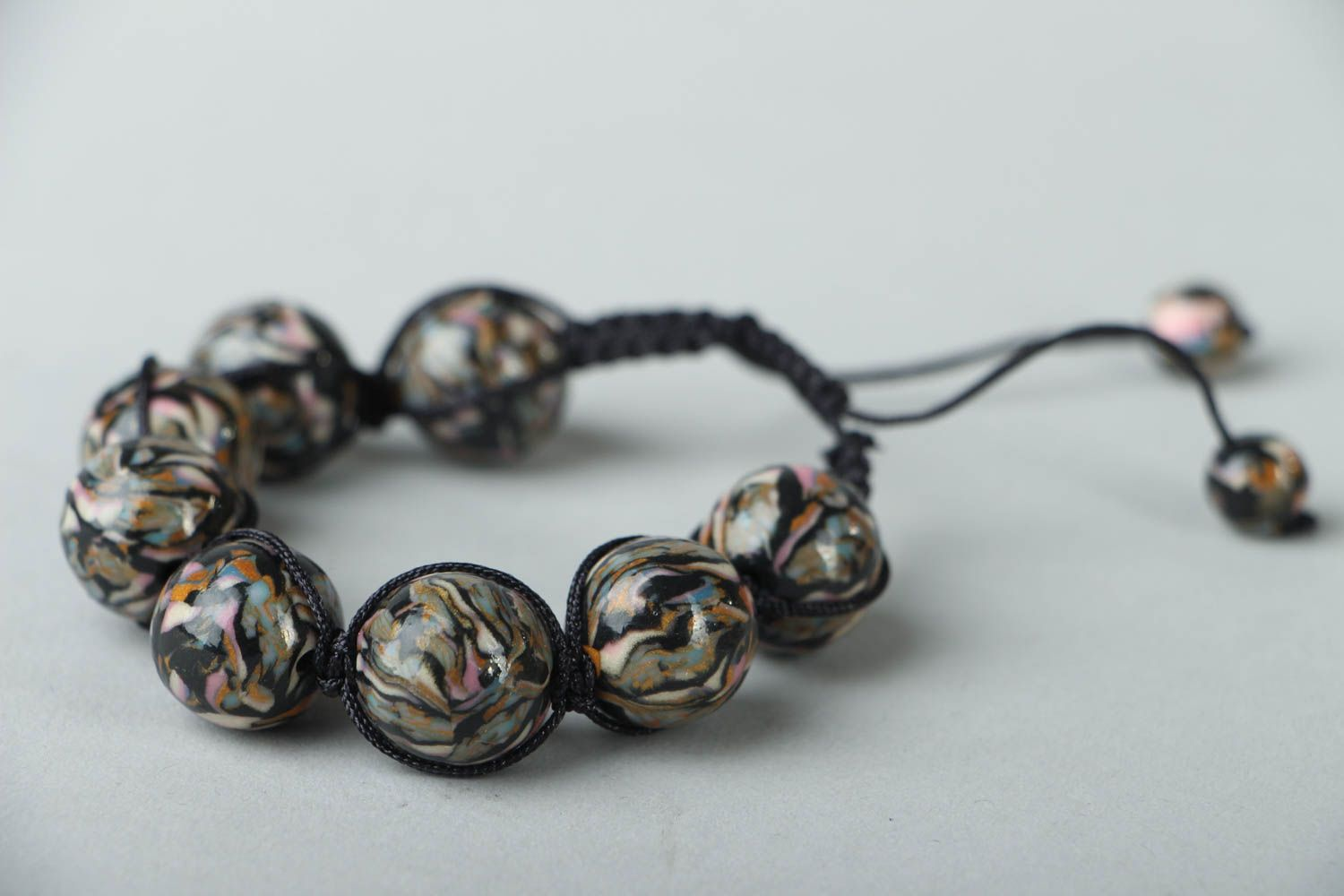 Woven bracelet with polymer clay beads photo 2