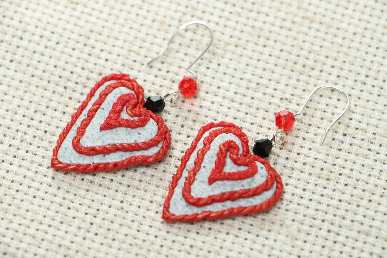 Heart-shaped plastic earrings photo 1