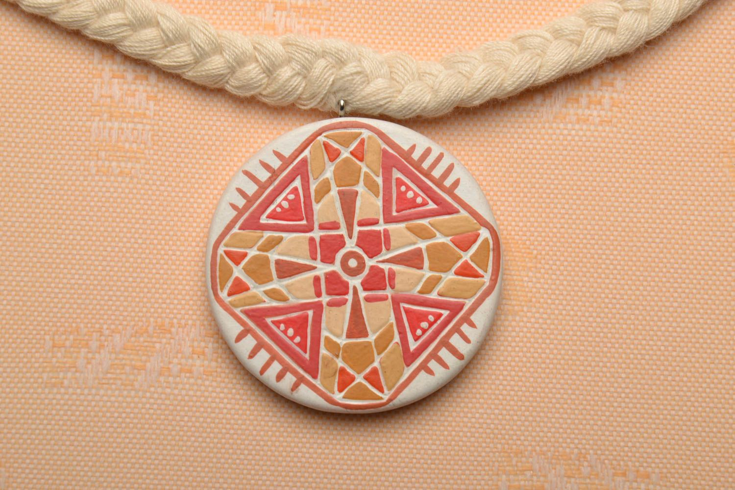 Wooden pendant with ornament photo 1