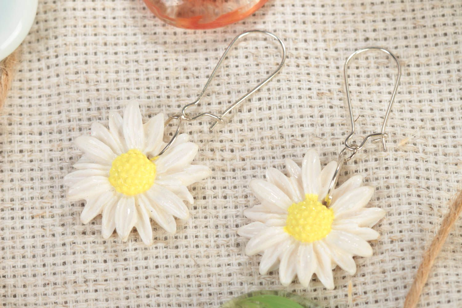 Handmade designer polymer clay dangling earrings with white chamomile flowers photo 1