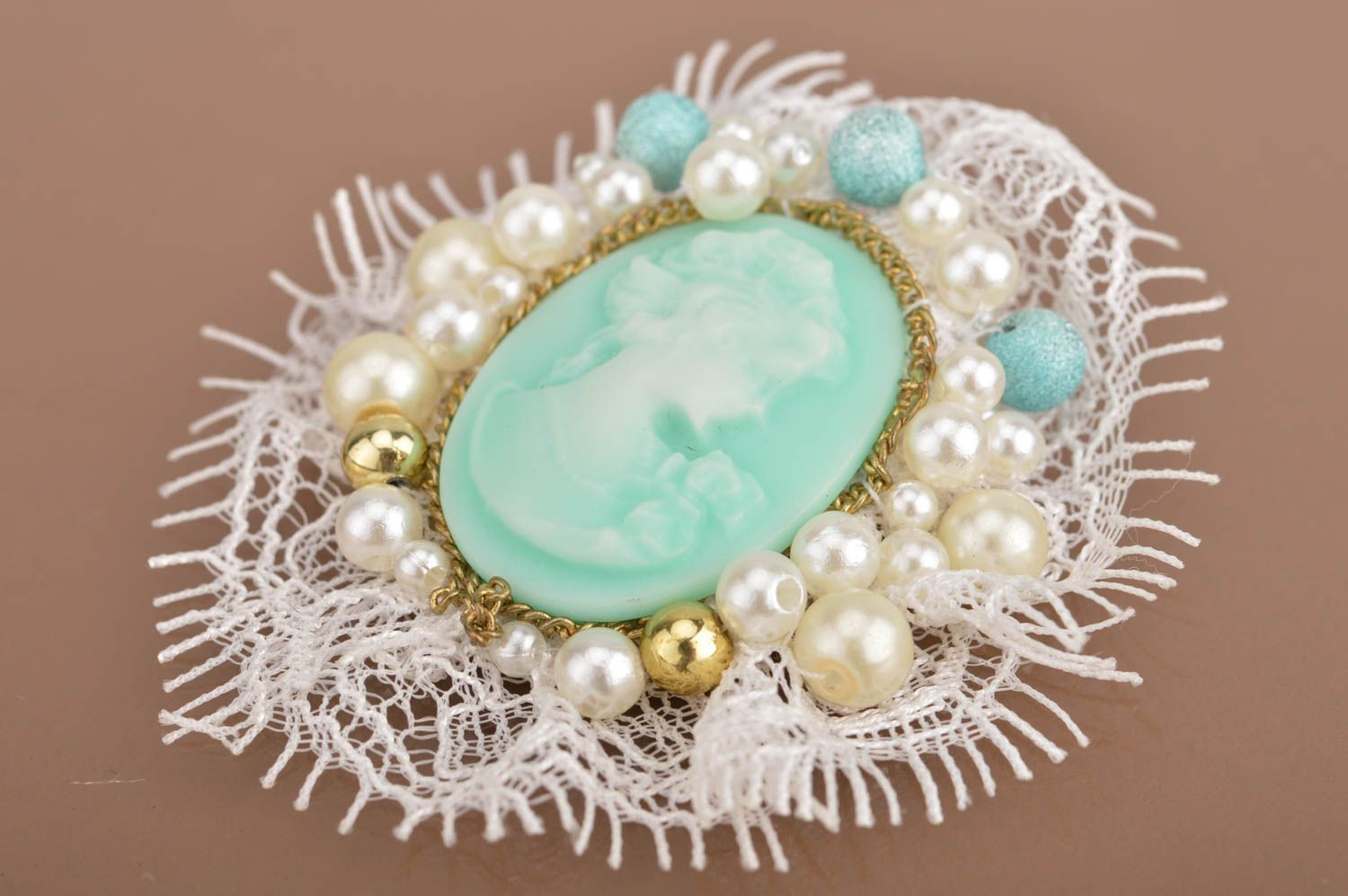 Handmade mint-colored cameo brooch with white lace accessory for women photo 2