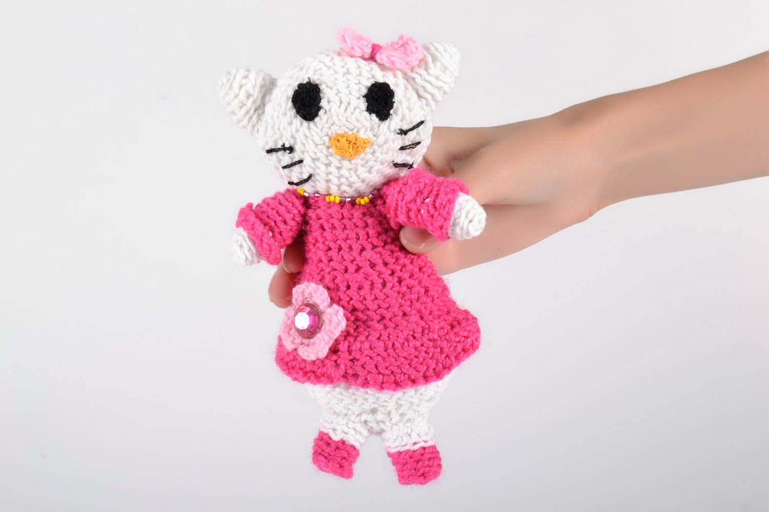 Toy crocheted around with wool threads photo 5