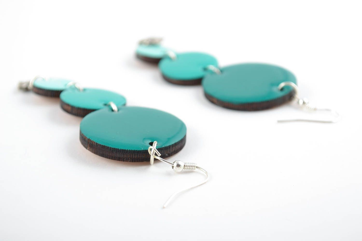 Handmade earrings made of wood and coated with epoxy resin turquoise color photo 3