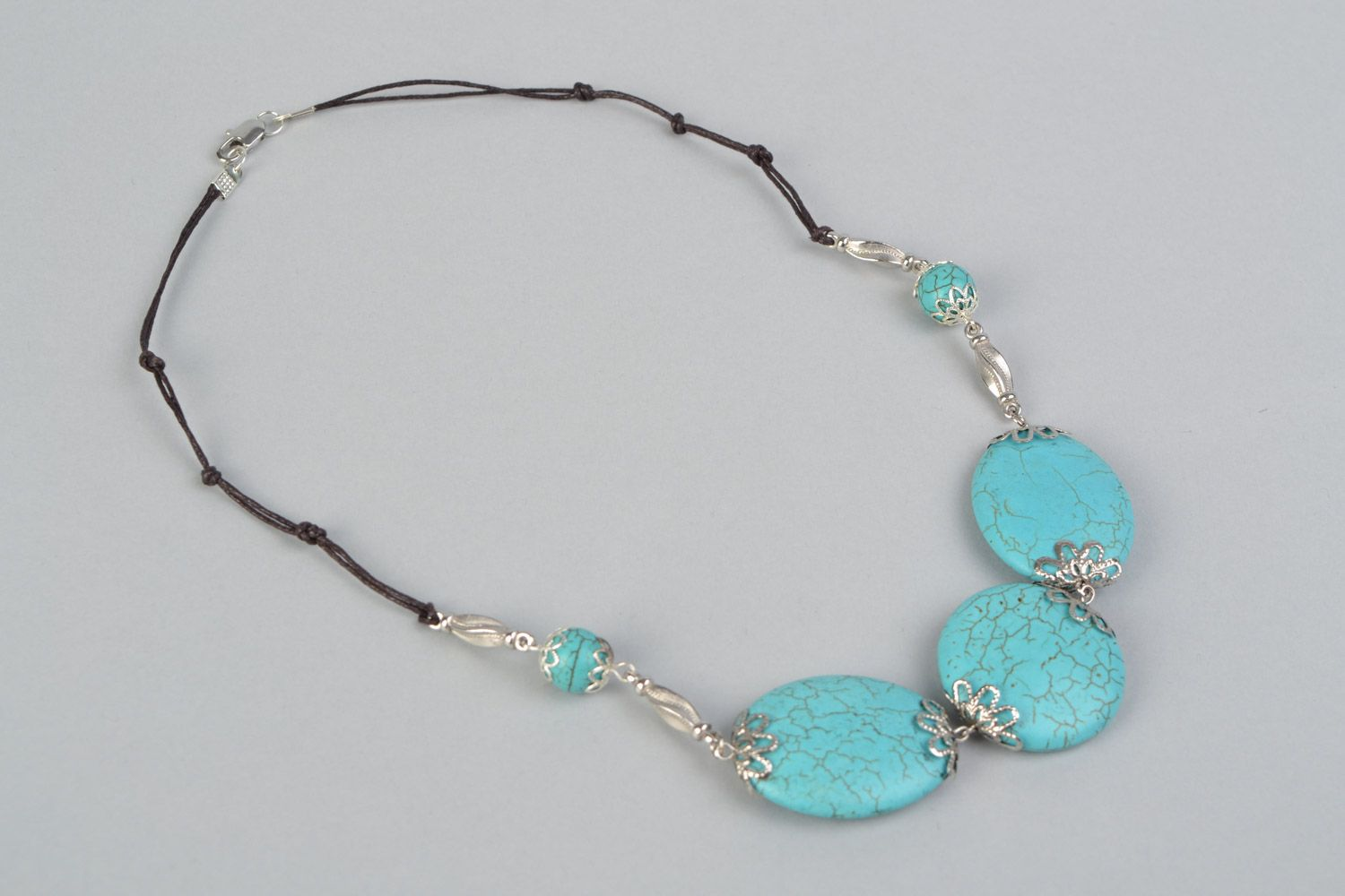 Handmade designer women's necklace with natural turquoise and on waxed cord  photo 2