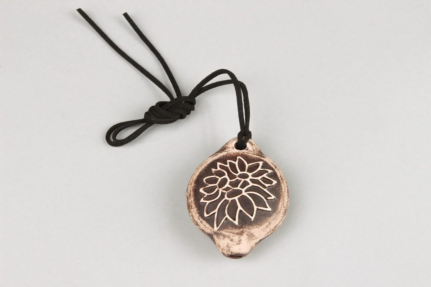 Tin whistle pendant made of clay with carving photo 1