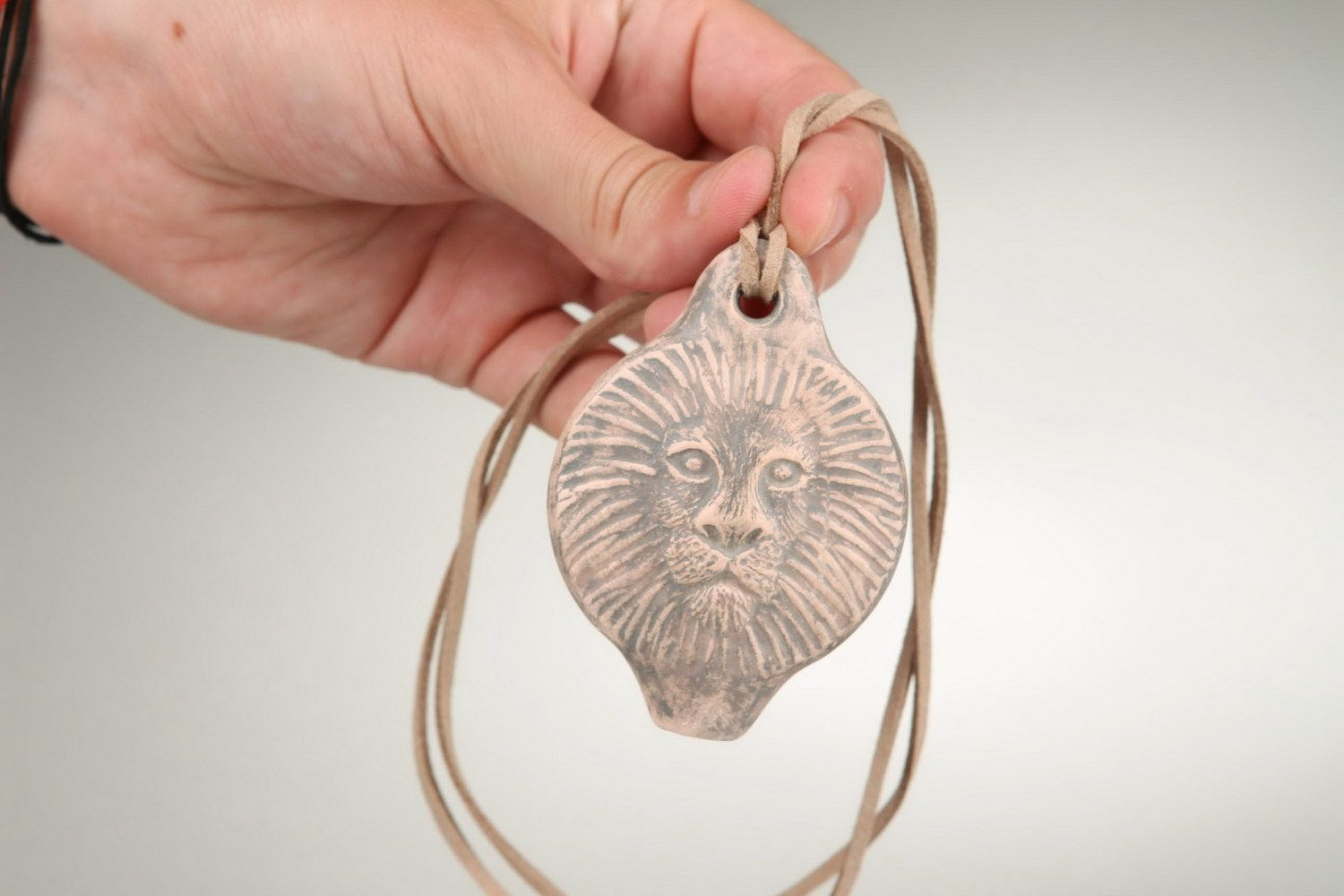 Ceramic tin whistle pendant in the form of lion's head photo 3