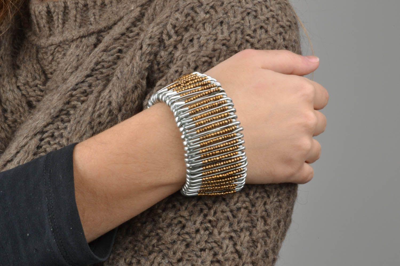 Woman's wrist bracelet made of pins photo 1