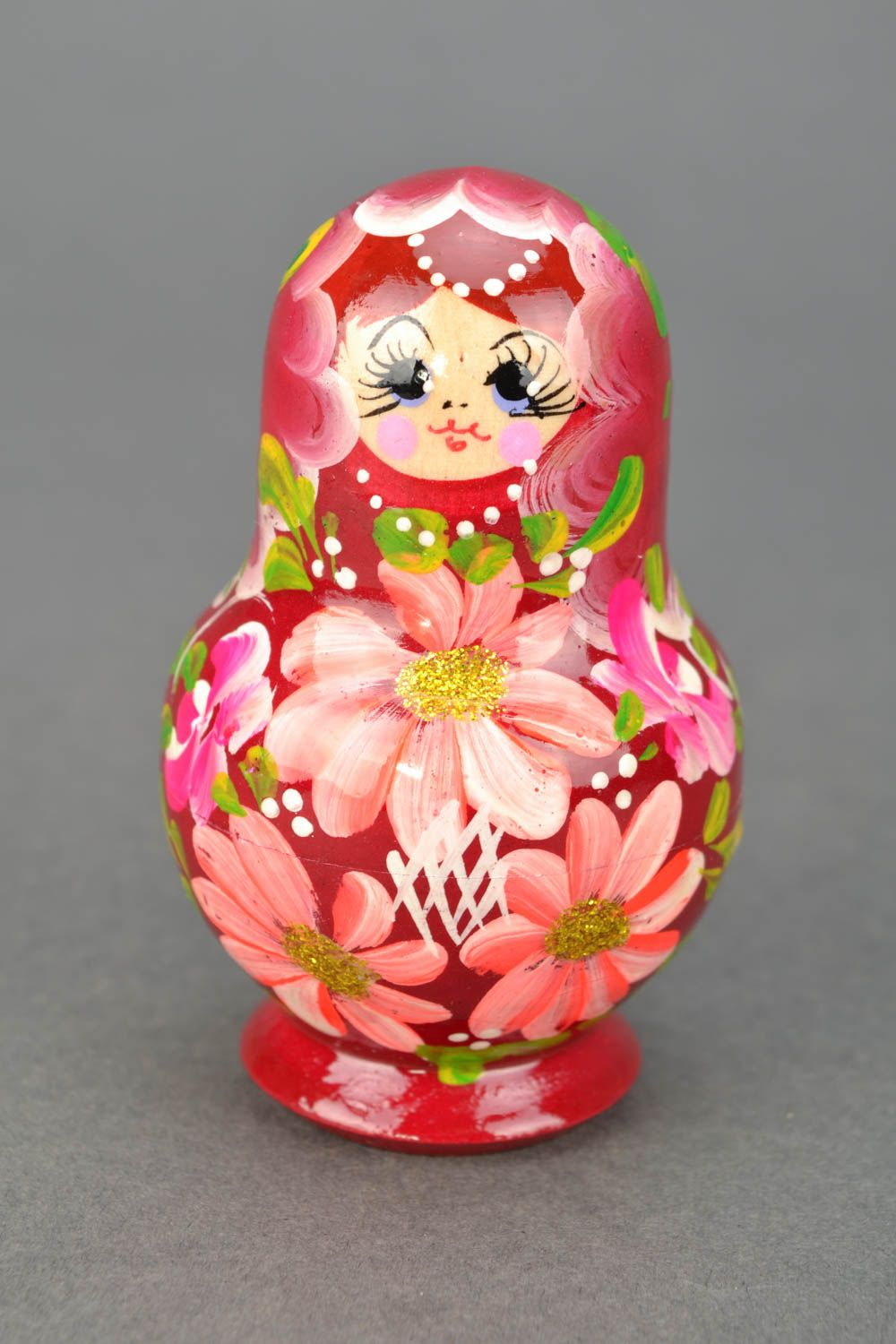 Painted wooden nesting doll photo 1