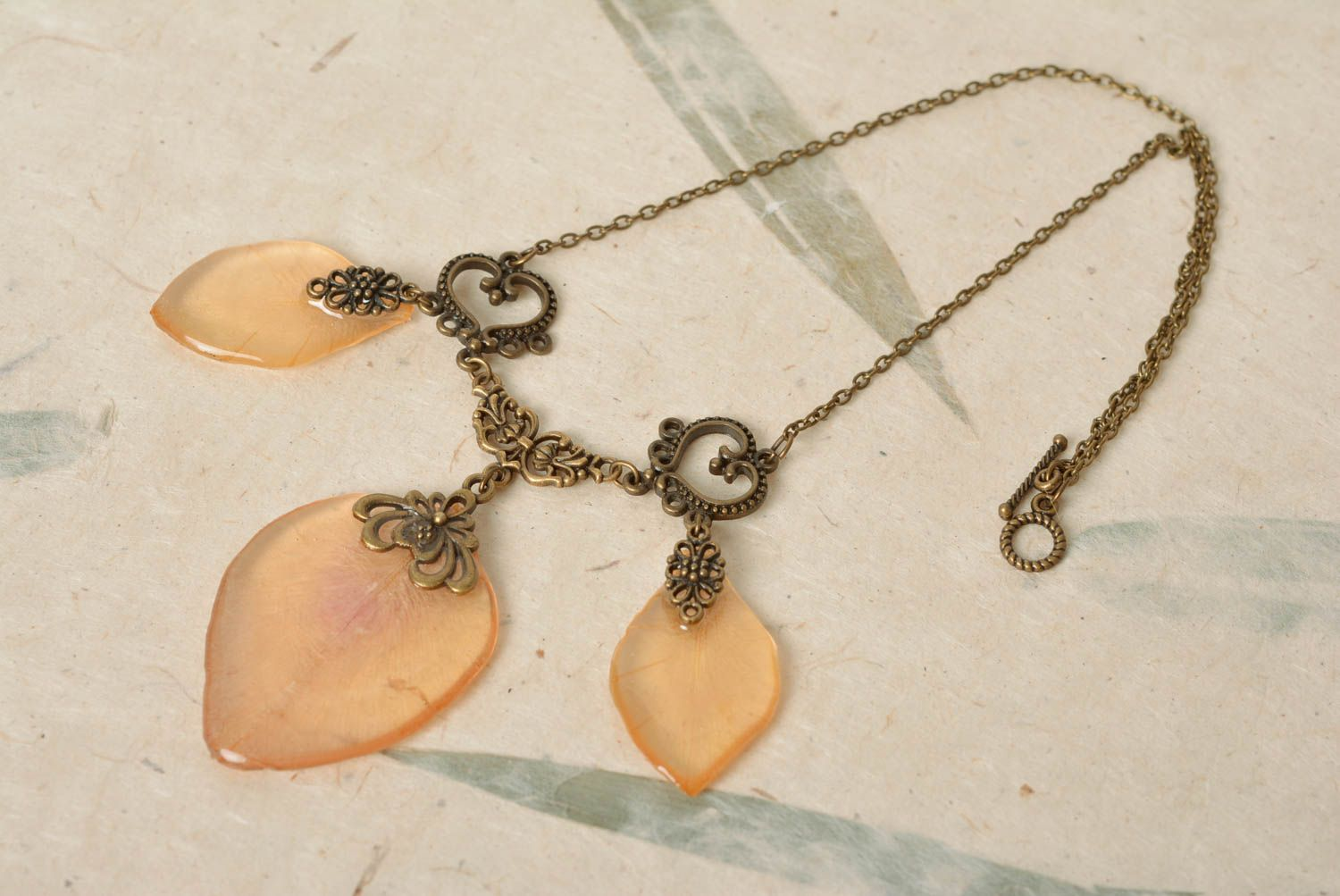 Beautiful handmade peach colored gentle necklace with epoxy coating on chain photo 1