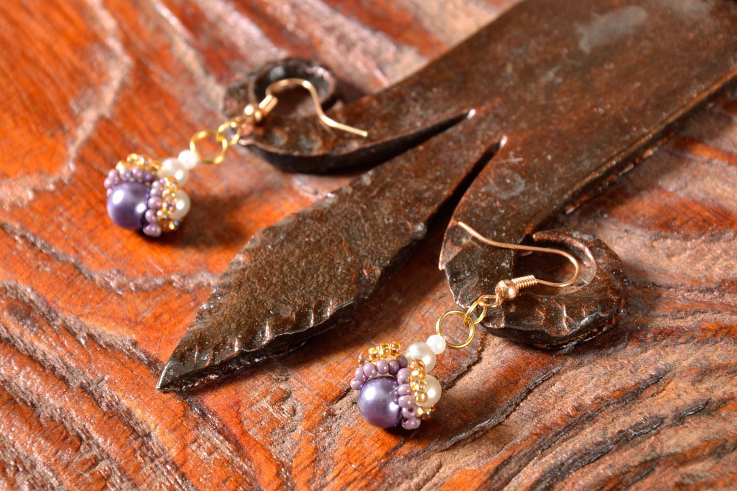 Beaded earrings with charms photo 1