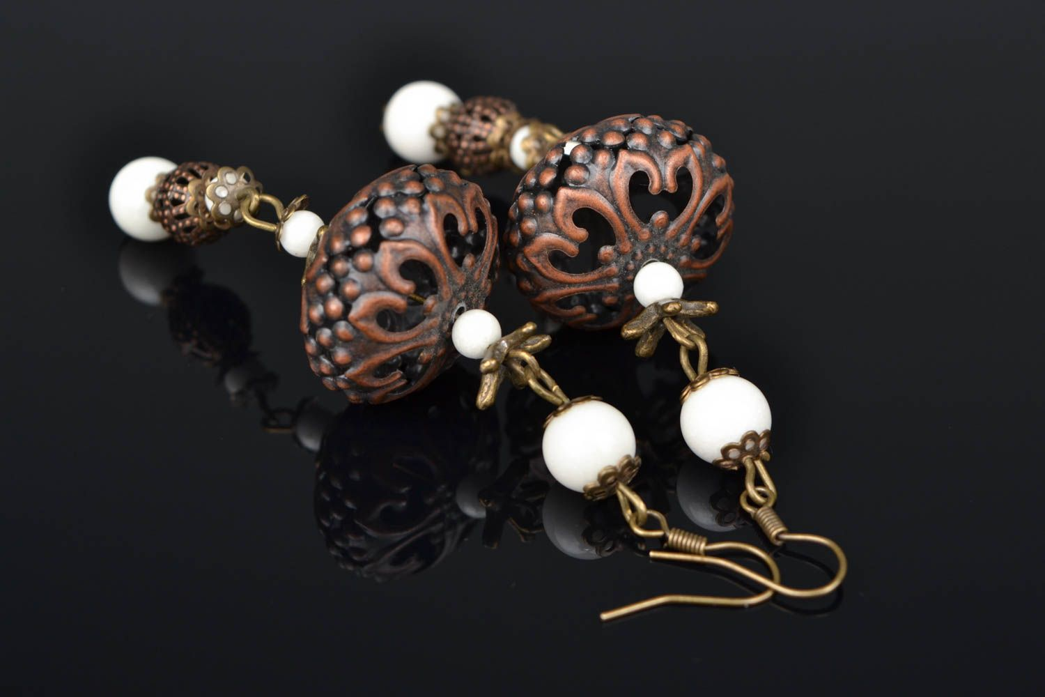 Metal earrings with ceramic beads photo 1