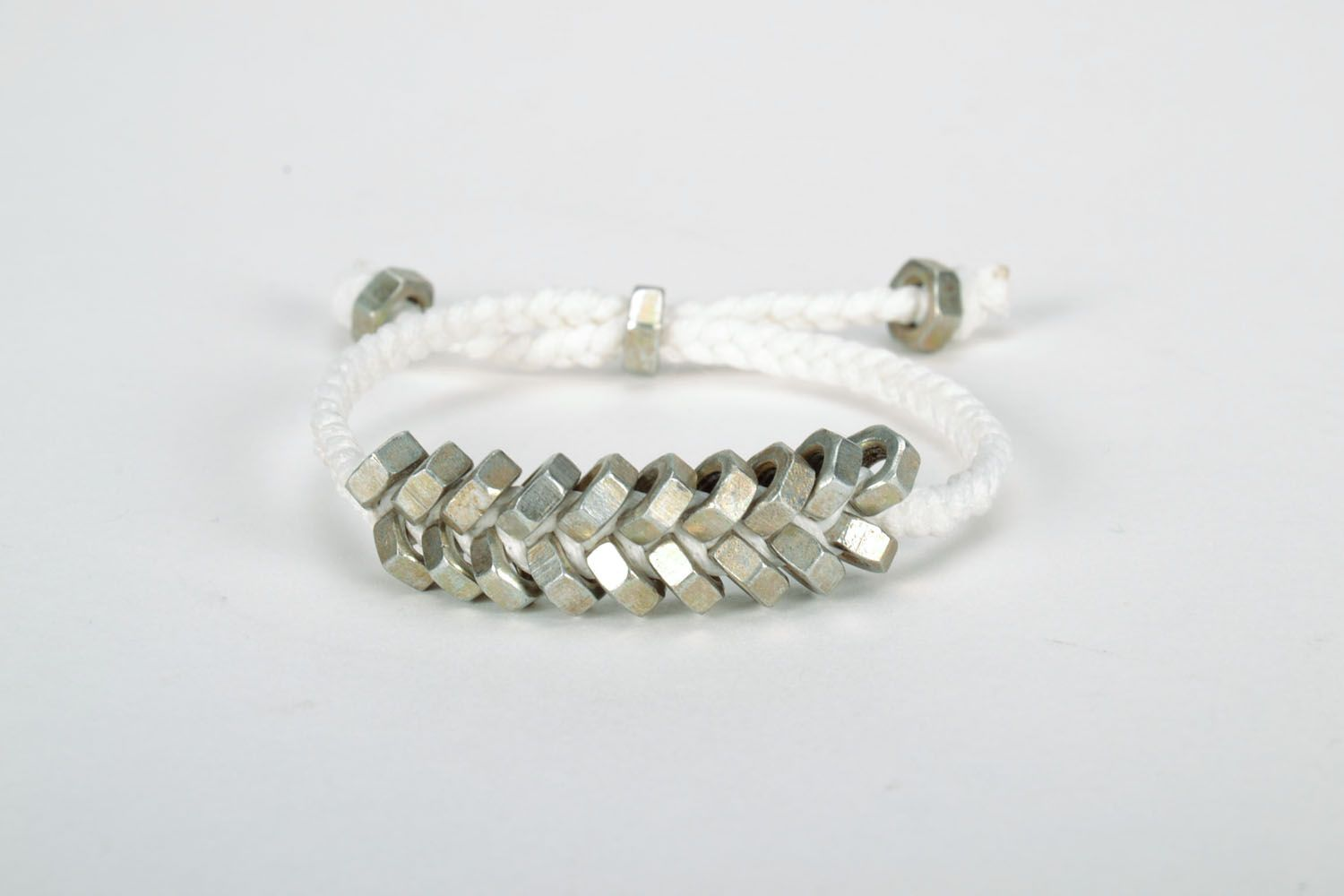 Homemade woven bracelet with metal nuts photo 2