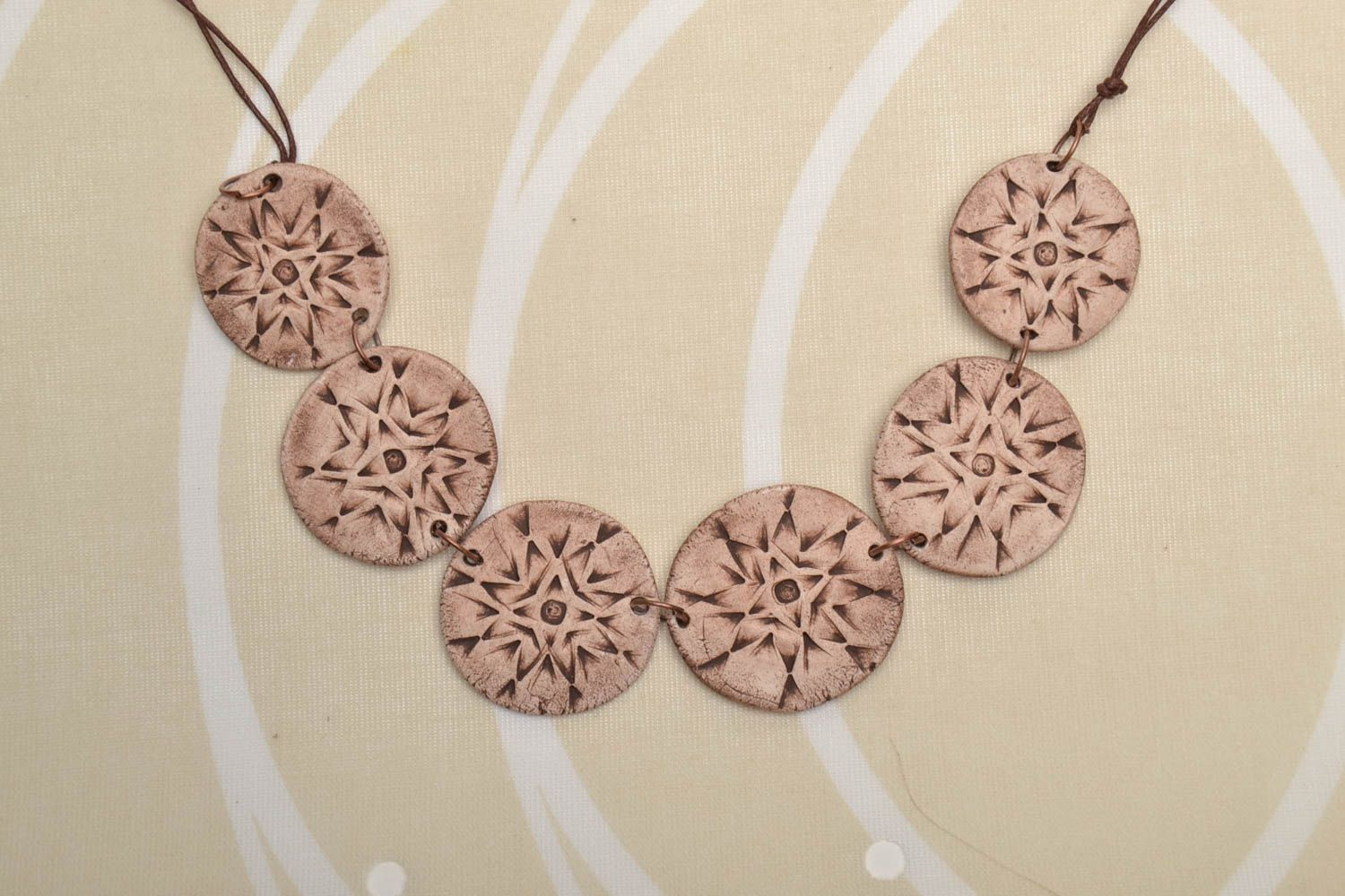 Ceramic necklace with ethnic ornaments photo 1