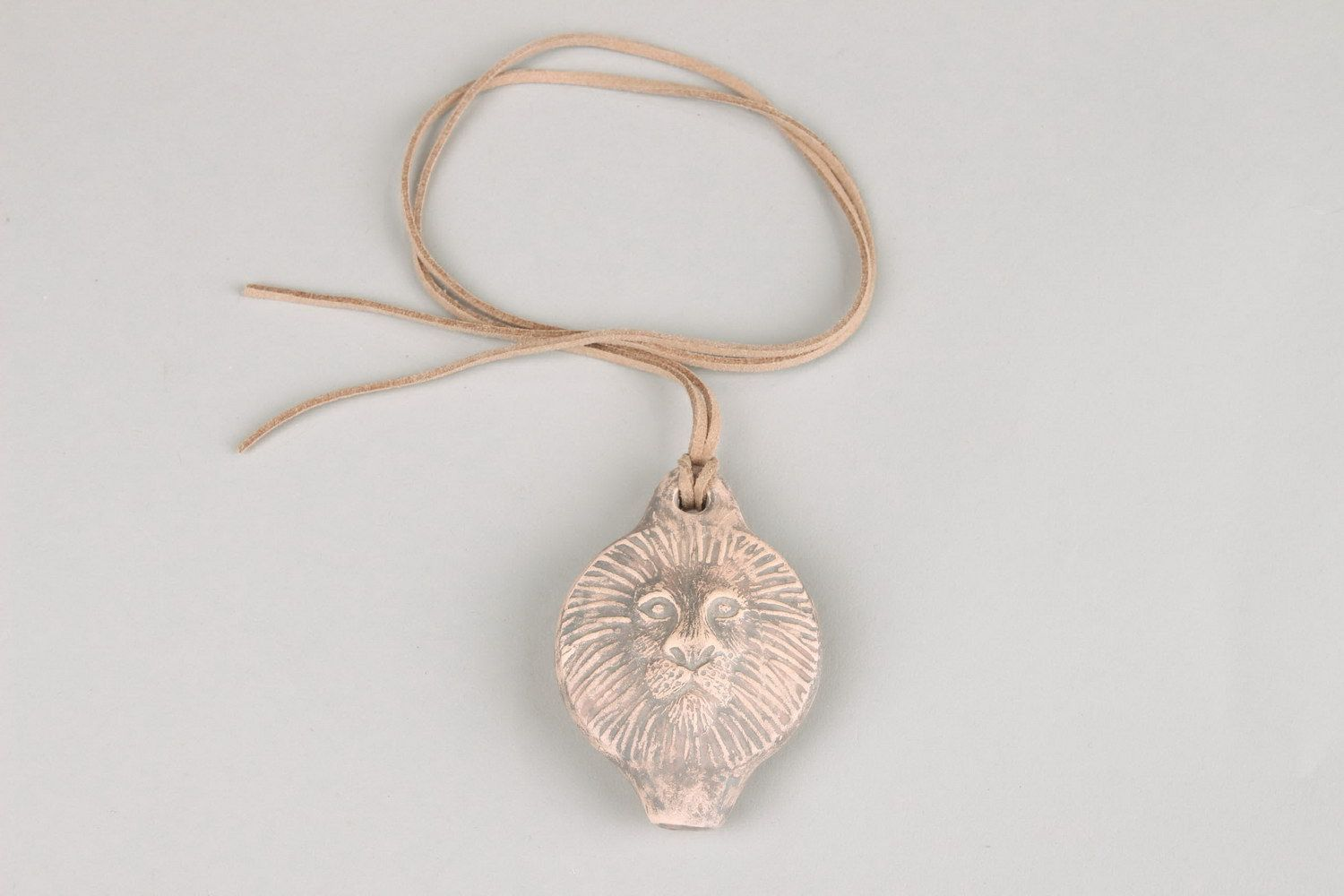 Ceramic tin whistle pendant in the form of lion's head photo 5