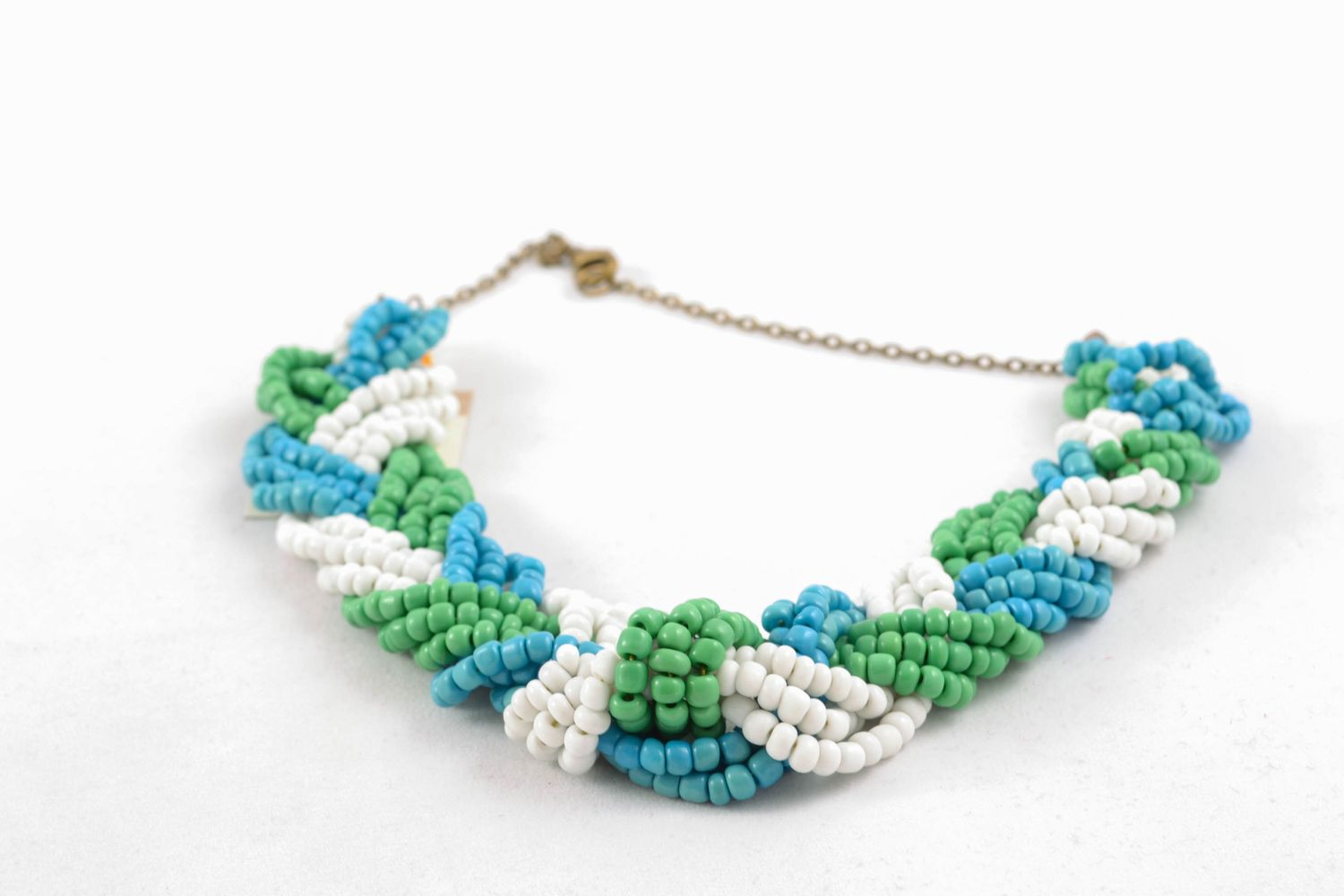 Light beaded necklace of three colors photo 4