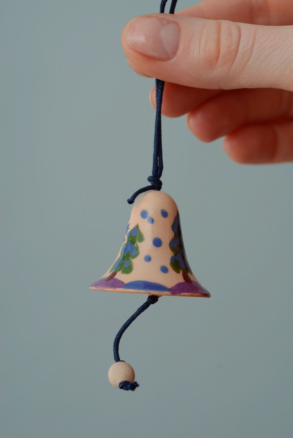 Small ceramic bell with a cord photo 4