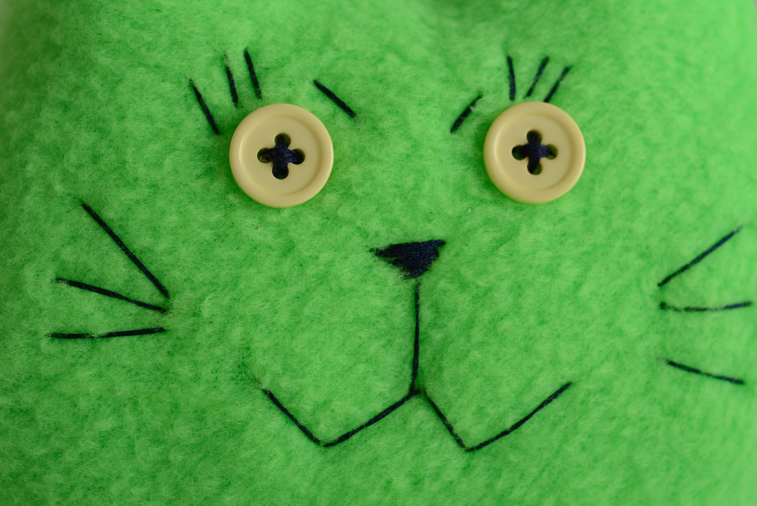 Soft toy in the shape of a green cat photo 2