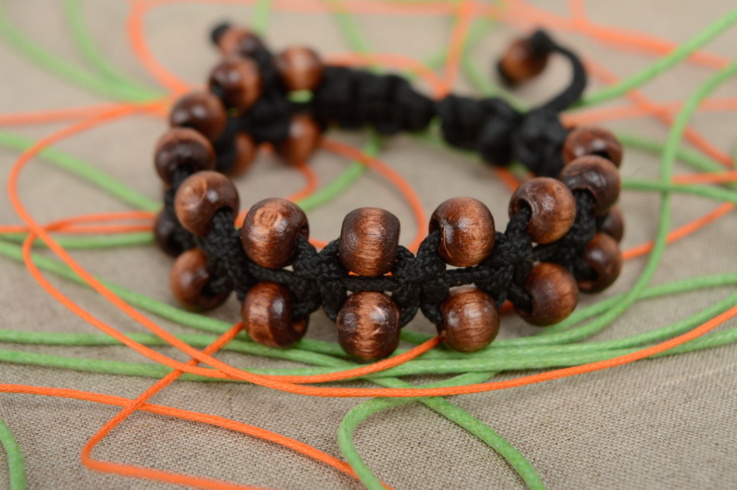 Macrame woven cord bracelet with wooden beads photo 2