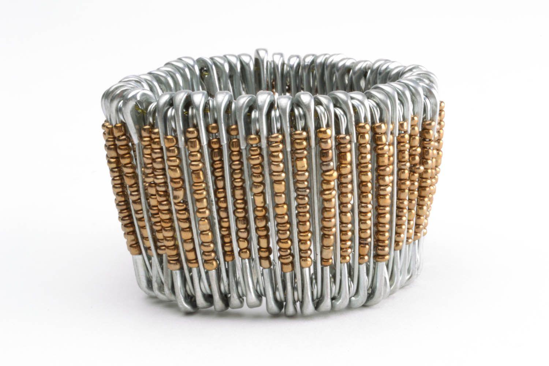 Woman's wrist bracelet made of pins photo 3