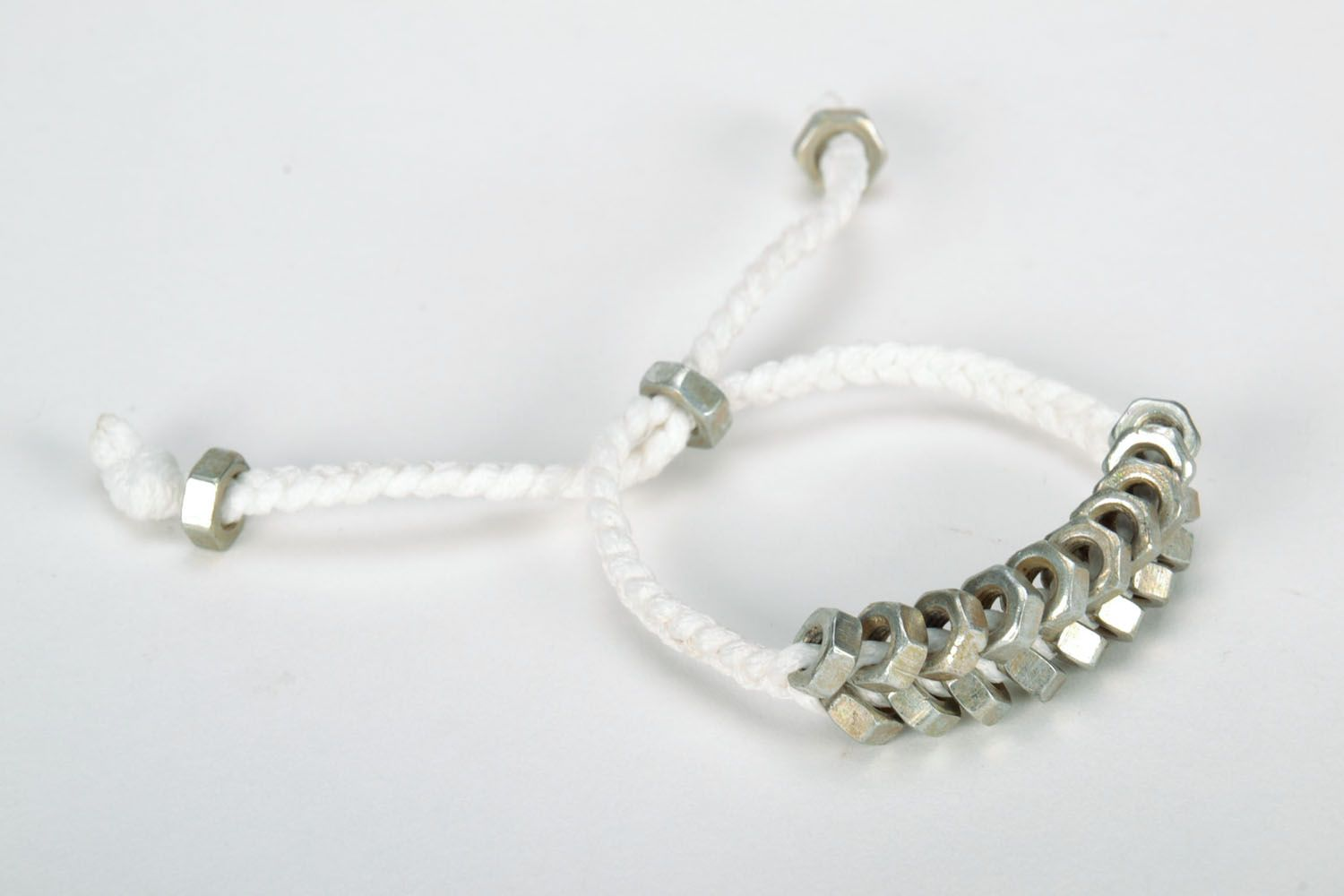 Homemade woven bracelet with metal nuts photo 4