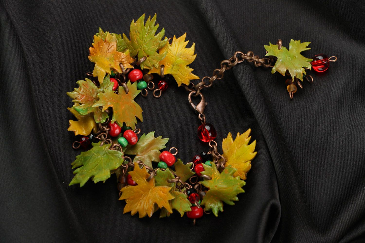 Plastic bracelet with charms in the shape of leaves photo 1