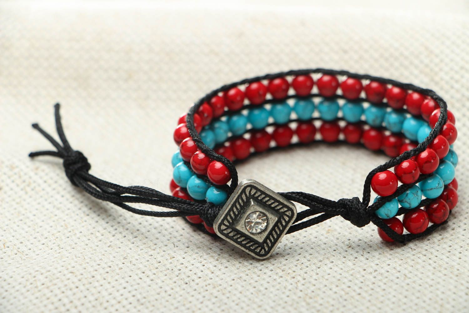 Woven bracelet with coral and turquoise photo 3