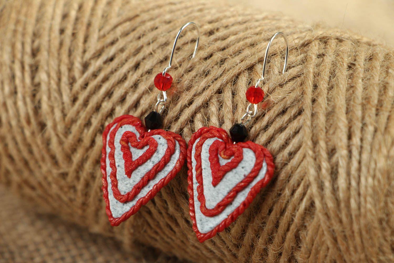 Heart-shaped plastic earrings photo 4