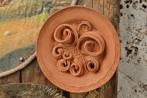 Unusual handmade decorative unpainted molded clay wall plate - MADEheart.com