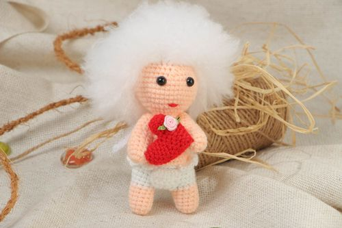 Handmade soft crochet toy in the shape of cute curly cupid with red heart - MADEheart.com