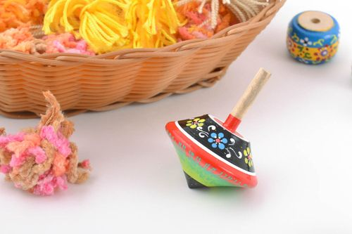 Beautiful painted handmade wooden spin top for children eco toy - MADEheart.com