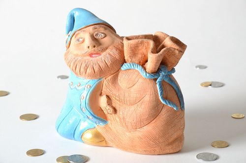 Clay money box in the shape of a man with a sack - MADEheart.com