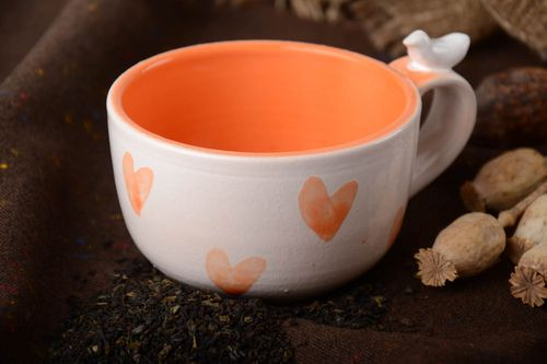 Handmade orange and white glazed ceramic tea cup with bird on handle 250 ml - MADEheart.com