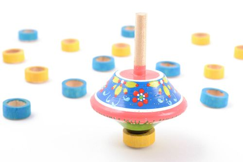 Pink handmade wooden spinning top toy painted with eco dyes - MADEheart.com