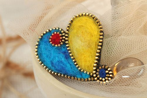 Yellow and blue handmade felted wool brooch in the shape of heart - MADEheart.com