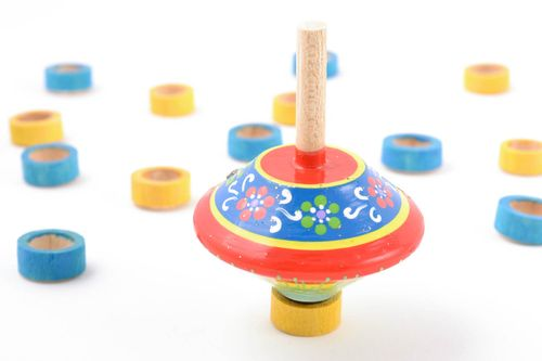 Handmade educational childrens toy spinning top painted with eco dyes - MADEheart.com