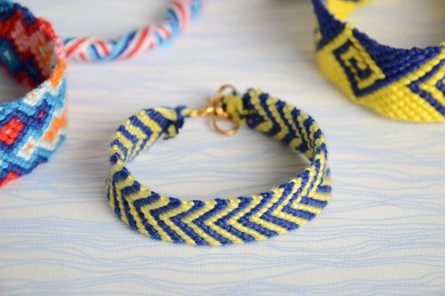 Braided handmade friendship bracelet made of floss thread delicate beautiful yellow and blue accessory - MADEheart.com