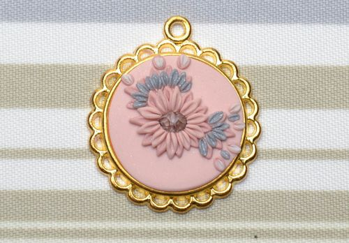 Polymer clay pendant with golden-colored frame - MADEheart.com