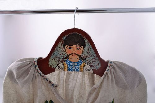 Handmade massive clothes hanger cut out of wood and painted with acrylics  - MADEheart.com