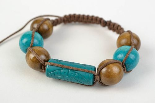 Handmade womens woven cotton cord wrist bracelet with wooden beads - MADEheart.com