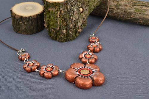 Handmade ceramic necklace on cord with molded flowers painted with acrylics - MADEheart.com