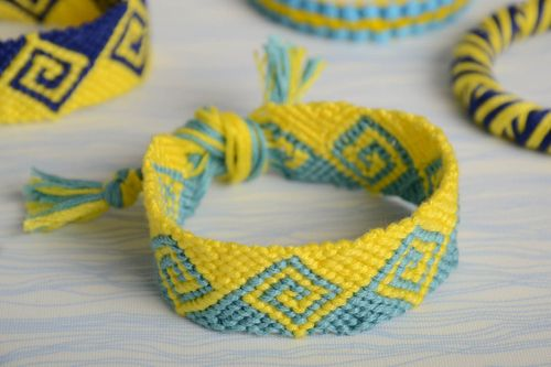 Yellow and blue handmade wide woven embroidery floss bracelet with ties - MADEheart.com